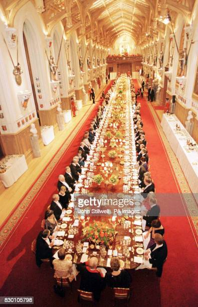 The Queen and guests seated in St George's Hall at State banquet at Windsor Castle