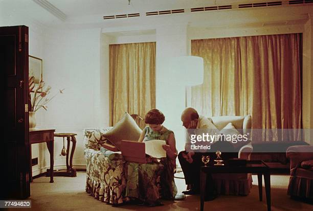 HM The Queen and her Private Secretary Sir Martin Charteris reviewing papers late at night on board HMY Britannia in March 1972 Part of a series of...
