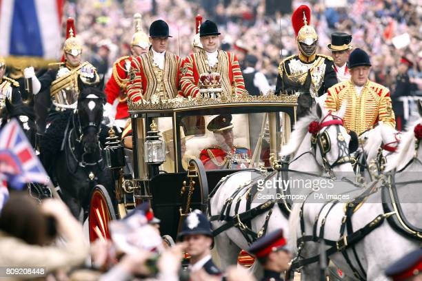 The Queen and Prince Philip The Duke of Edinburgh travel in a SemiState Landau carriage along the Processional Route to Buckingham Palace in London...