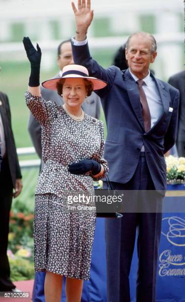 The Queen And Prince Philip Waving Together During A Visit To The Selangor Turf Club In Malaysia