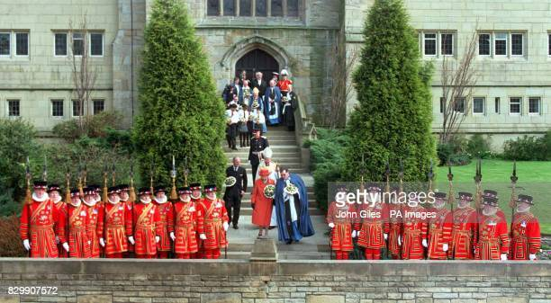 The Queen and the Duke of Edinburgh are escorted down the steps of Bradford Cathedral this afternoon after taking part in the traditional Maundy...