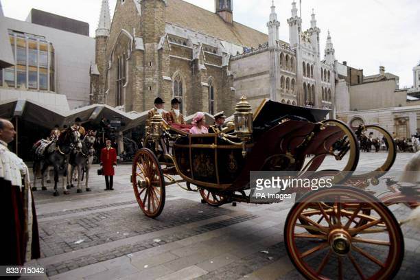 The Queen and the Duke of Edinburgh in the open landau as they left the Guildhall for the return processional drive to Buckingham Palace