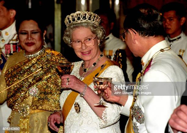 The Queen and the King of Thailand toast each other at the Senate Banquet in the Chakri Palace Throne Hall in Bangkok