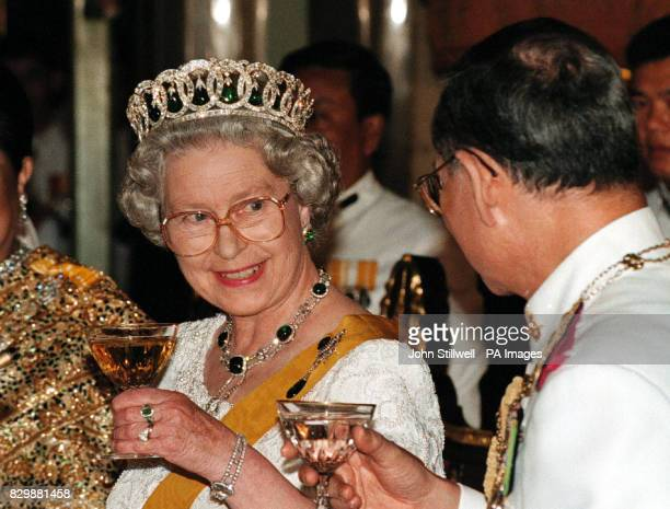 The Queen and the King of Thailand toast each other at the state banquet in the Chakri Palace throne hall in Bangkok this evening Photo by John...
