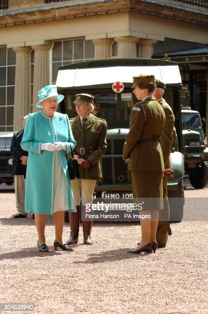 The Queen and The Princess Royal who is CommandantinChief of the First Aid Nursing Yeomany arrives to inspect vintage vehicles used by the yeomanry...