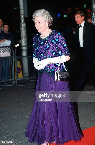 The Queen Arriving At The Dominion Theatre For The Royal Variety Performance She Is Wearing A Dress By Fashion Designer John Anderson