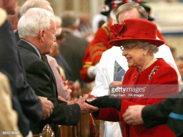 The Queen at St Patrick's Cathedral in Armagh city Northern Ireland for the Traditional Maundy Service where she is presenting Maundy Money to 82 men...