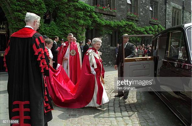 The Queen At The Order Of The Bath Ceremony At Westminster Abbey London Holding The Car Door Open Is Her Police Bodyguard David Robinson
