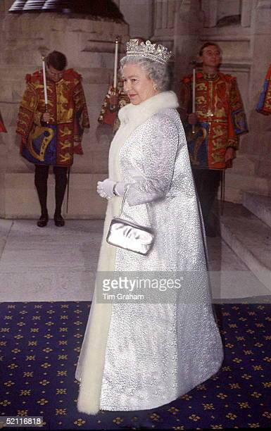 The Queen At The Sovereign's Entrance Of The Houses Of Parliament Wearing A Furtrimmed Full Length Silver Coat And A Tiara For The State Opening Of...