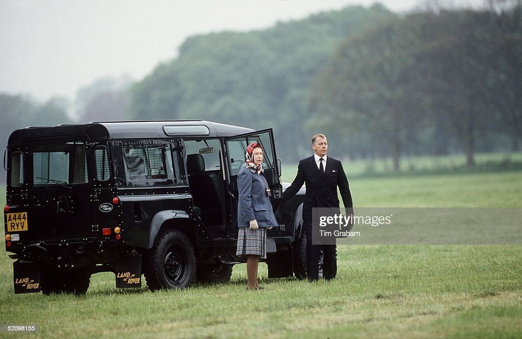 The Queen At The Windsor Horse Show Stands With Her Chauffeur At Her 4wheel Drive Vehicle Land Rover Defender