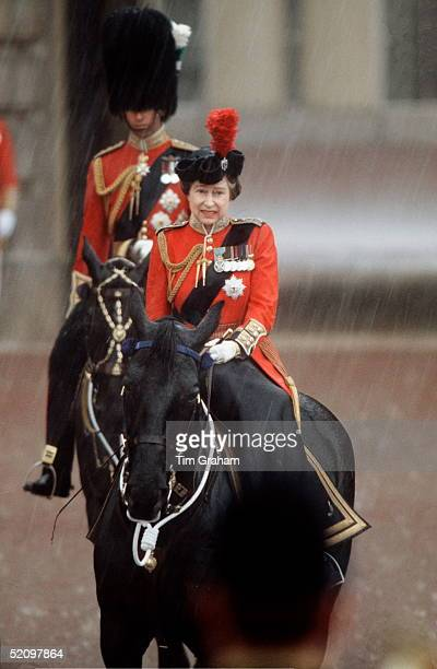 The Queen At Trooping The Colour Caught In A Downpour Of Rain
