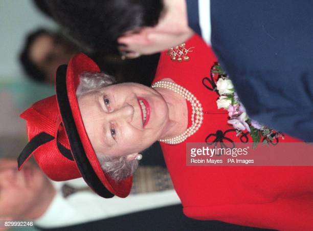 The Queen chats with nursing staff during a visit today to the United Kingdom Central Council for Nursing Midwifery and Health Visiting NPA /Times...