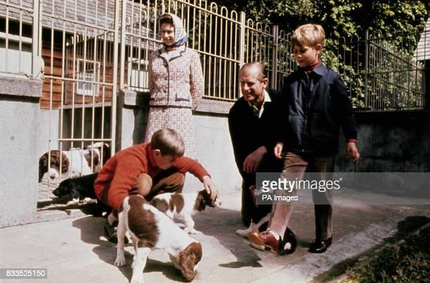 The Queen Duke of Edinburgh and their two sons Prince Andrew and Prince Edward visit the kennels at Balmoral