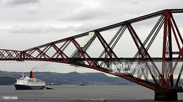 The Queen Elizabeth 2 anchors alongside the Forth bridges September 18 2007 in Edinburgh Scotland The QE2 will be delivered to Dubai in November 2008...