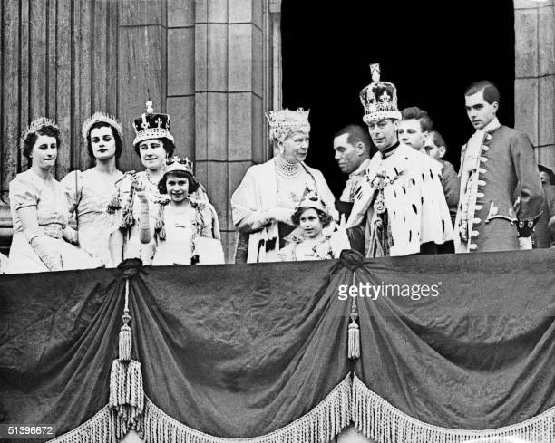 The Queen Elizabeth her daughter Princess Elizabeth Queen Mary Princess Margaret and the King George VI pose at the balcony of the Buckingham Palace...