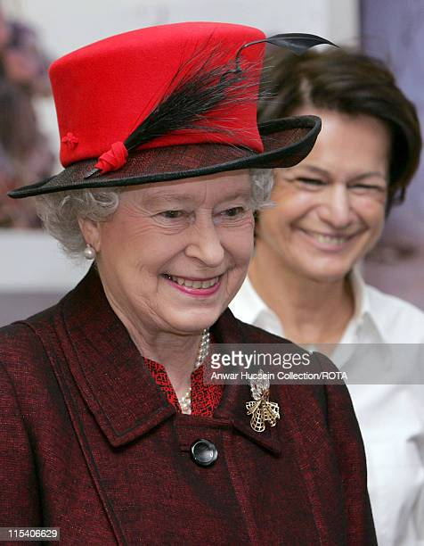 HM The Queen Elizabeth II is shown around by Reuters' Senior Vice President and Global Head of News and Pictures Monique Villa during a visit to the...