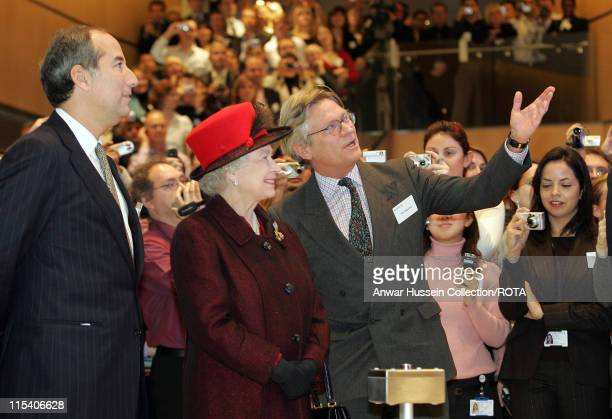 HM The Queen Elizabeth II looks up with Reuters Chief Executive Tom Glocer and Reuters journalist Paul Majendie during a visit to the Reuters...