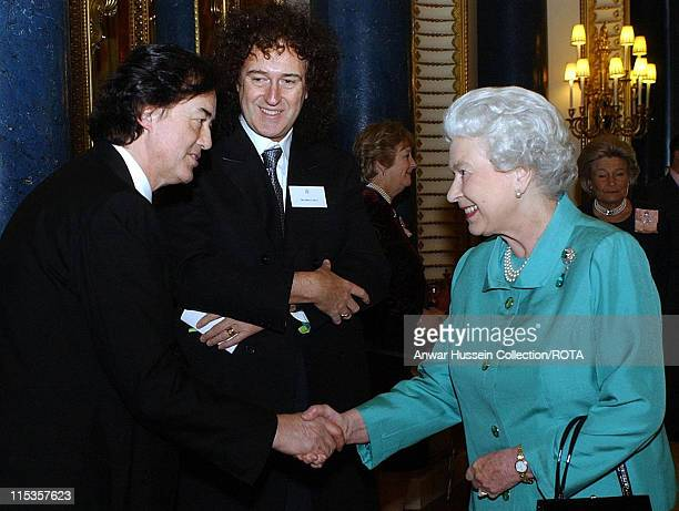 HM The Queen Elizabeth II meeting legendary rock guitarists Jimmy Page of Led Zeppelin and Brian May of Queen during a reception hosted by the Queen...