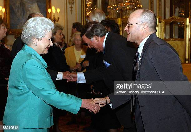 HM The Queen Elizabeth II meeting Phil Collins of Genesis during a reception hosted by the Queen at Buckingham Palace in Central London on Tuesday...