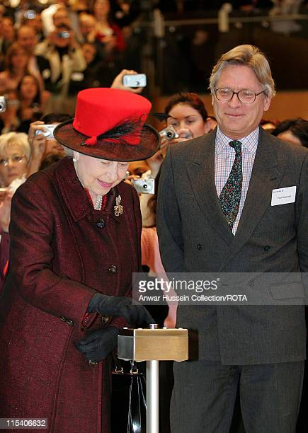 HM The Queen Elizabeth II presses a button to file a news story written by Reuters journalist Paul Majendie during a visit to the Reuters building in...