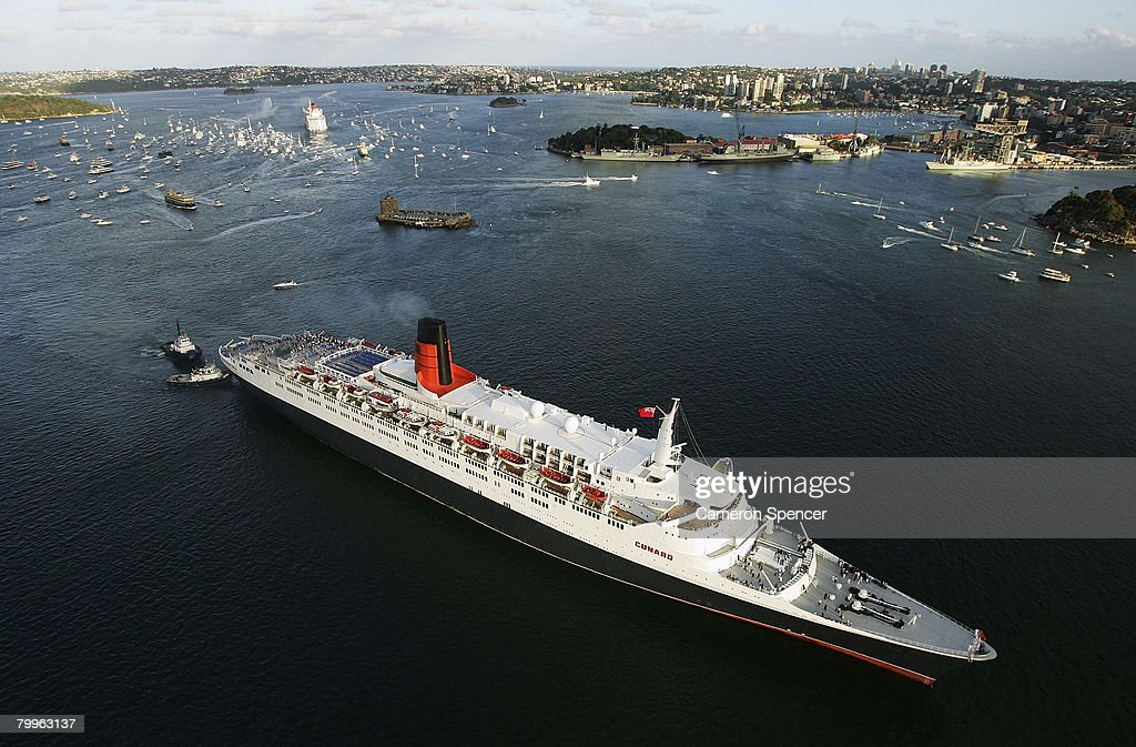 The Queen Elizabeth II (QE2) ship heads to the Overseas Passenger terminal after a rendezvous with fellow Cunard luxury liner the Queen Victoria at Garden Island in Sydney Harbour on their final and first voyages to Sydney respectively, on February 24, 2008 in Sydney, Australia. The QE2 is visiting Australian waters for the last time on her 30th anniversary of first doing so, before being retired as a floating hotel in Dubai. The Queen Victoria made her first visit to Sydney overnight and now departs for Brisbane and then Port Douglas on her maiden Australian voyage.