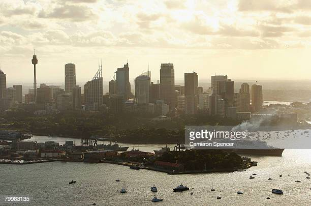 The Queen Elizabeth II ship leaves Garden Island for a rendezvous with fellow Cunard luxury liner the Queen Victoria at Fort Denison in Sydney...
