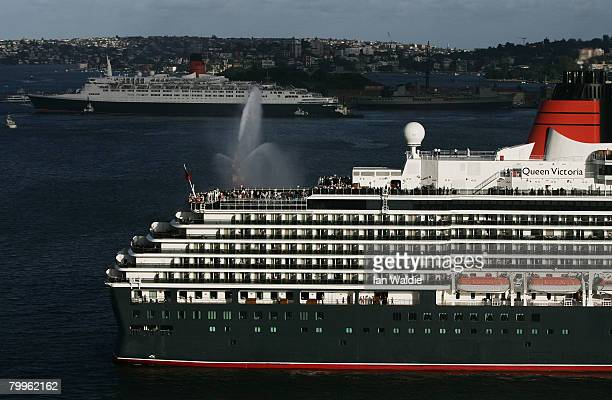 The Queen Elizabeth II ship prepares to pass fellow Cunard luxury liner the Queen Victoria at Garden Island in Sydney Harbour on their final and...