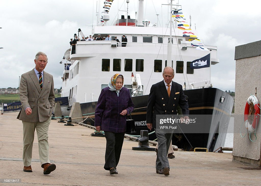 The Queen Elizabeth II with Prince Philip, The Duke of Edinburgh accompanied by the Prince Charles, Prince of Wales as they leave the Hebridean Princess boat after a family holiday around the Western Isles of Scotland, on August 02, 2010 in Scrabster, Scotland.