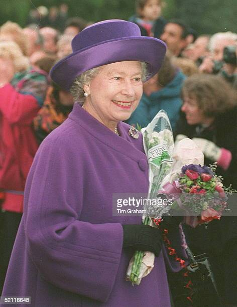 The Queen Holding Flowers Outside Sandringham Church On Christmas Day