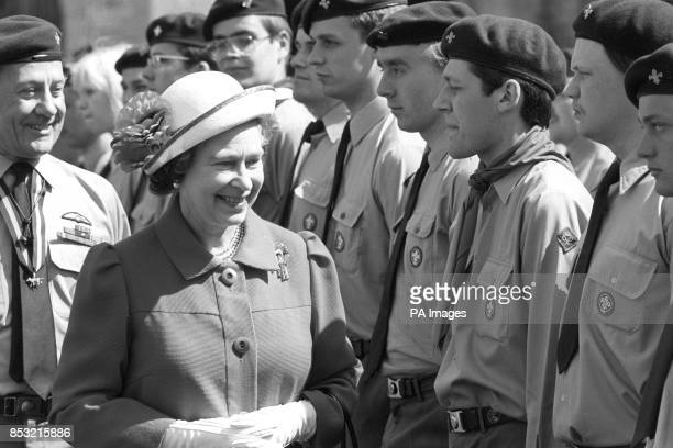 The Queen in her capacity as patron of the Scout Association reviews some of the 1000 Queen's Scouts who turned out for the St George's Day parade at...