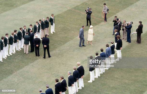 HM The Queen is accompanied by MCC president Peter May to meet England captain Ian Botham and the rest of the England team during the 2nd Test match...