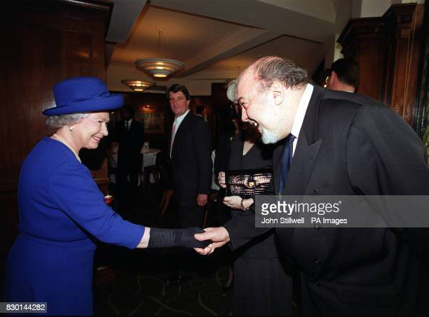 The Queen is greeted by distinguished theatre director Sir Peter Hall during her visit to the Almeida Theatre in London part of a tour by The Queen...
