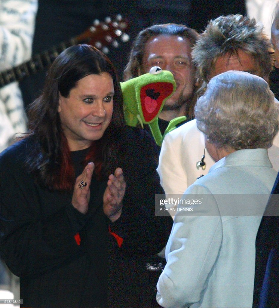The Queen is introduced to Ozzy Osbourne and Kermit the Frog on stage during 'Party at the Palace' in London 03 June 2002 As part of Queen...
