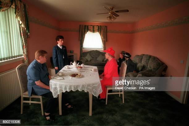The Queen joined Mrs Susan McCarron her ten yearold son James and Housing Manager Liz McGuinnis for tea in their home in the Castlemilk area of...