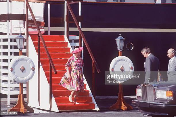 The Queen Leaving Royal Yacht Britannia At The Start Of A Tour Of Cyprus She Is Greeted By The British High Commissioner