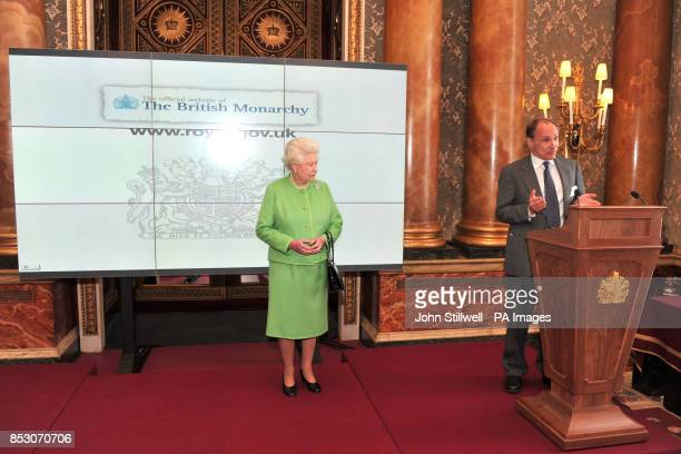 The Queen listens on as World Wide Web inventor Sir Tim BernersLee gives a speech at the launch of the new British Monarchy website