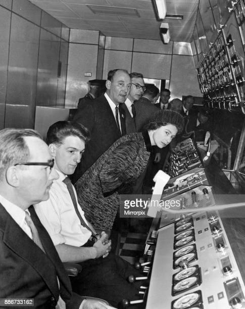 The Queen looks out from the control room at Spencer Works and watches an ingot being rolled through the Cold Rolling Mill 26th October 1962