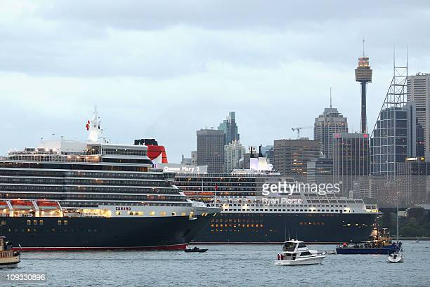 The Queen Mary 2 passes the Queen Elizabeth in Sydney Harbour on February 22 2011 in Sydney Australia The voyage marks the new Queen Elizabeth's...