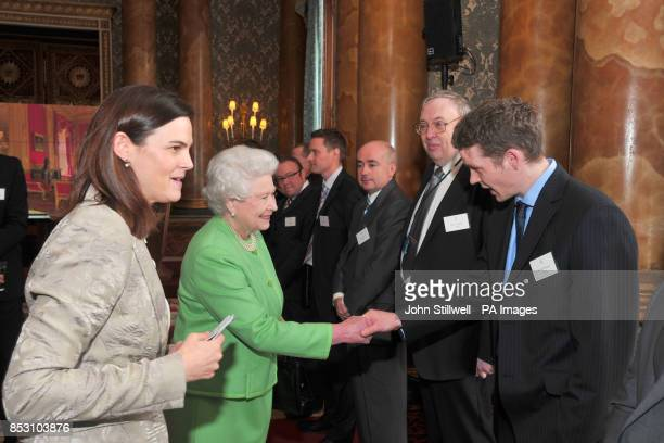 The Queen meets Mr Will Pearson at the launch of the new British Monarchy website