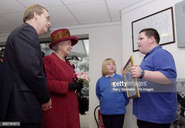 The Queen meets pupils Charlie Harrison 10 and Ryan Butland as head teacher David Thorley looks on after she officially opened Pembroke Dock...