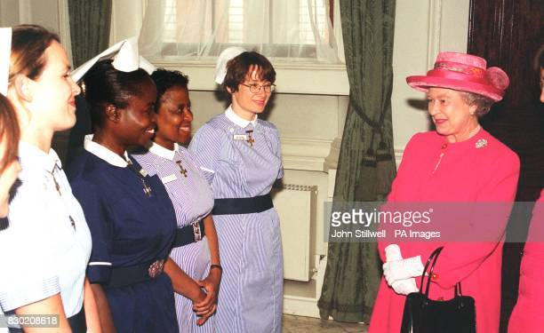 The Queen meets some nurses at a reception given by the Royal College of Nursing to mark the centennial meeting of the International Council of...