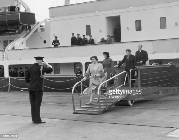 The Queen Mother and Princess Margaret step off the royal yacht Britannia at Portsmouth after saying goodbye to Prince Charles and Princess Anne 14th...