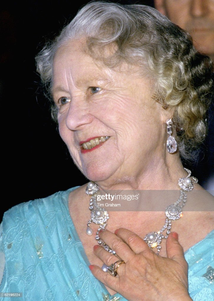 The Queen Mother at an evening engagement wearing the ring given to Camilla Parker-Bowles as an engagement ring. The necklace had been a gift to Princess Alexandra of Denmark from her future husband the Prince of Wales and worn on their wedding day in 1863.