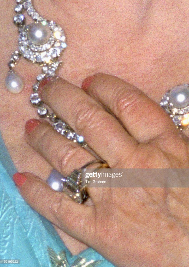 The Queen Mother at an evening engagement wearing the ring later given to Camilla Parker-Bowles as an engagement ring. The necklace had been a gift to Princess Alexandra of Denmark from her future husband the Prince of Wales and worn on their wedding day in 1863