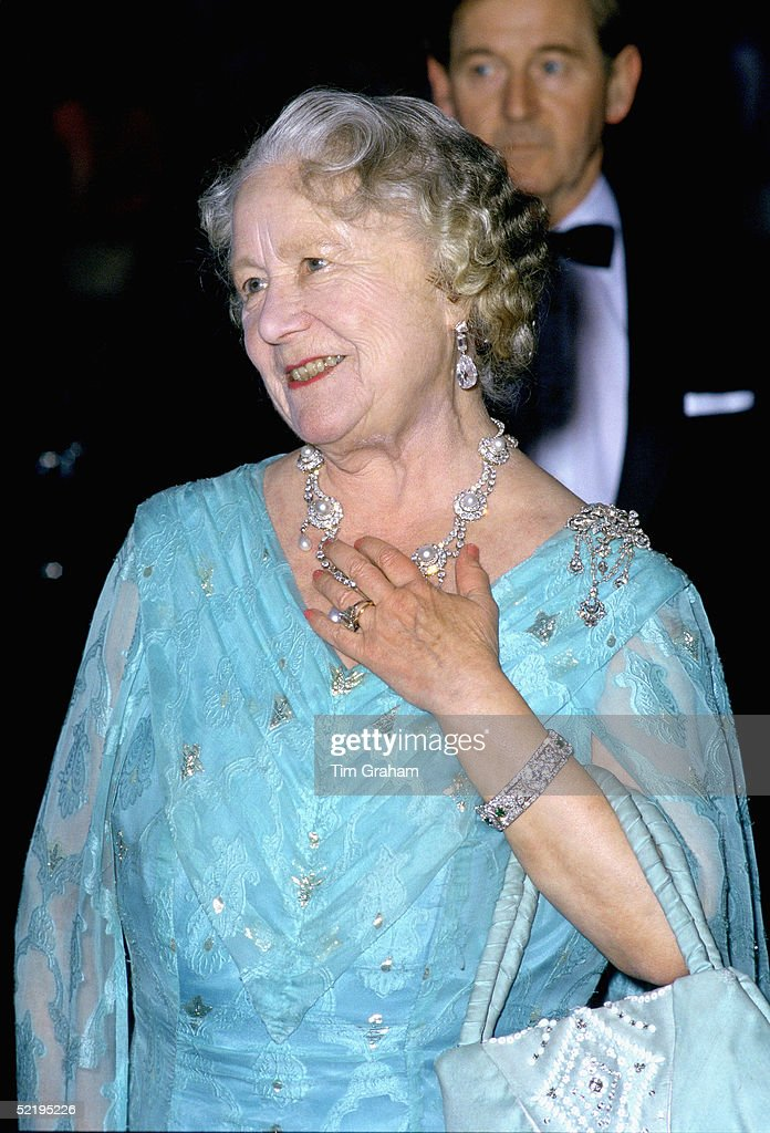 The Queen Mother at an evening engagement wearing the ring later given to Camilla Parker-Bowles as an engagement ring. The necklace had been a gift to Princess Alexandra of Denmark from her future husband the Prince of Wales and worn on their wedding day in 1863. The diamond brooch was a wedding day gift to the Queen Mother from her husband King George VI.