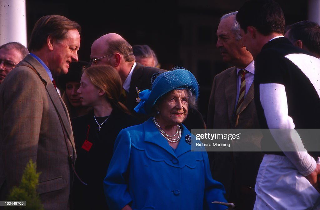 The Queen Mother attends the Grand Military Gold Cup accompanied by Andrew Parker-Bowles (left). Held annually at Sandown Park Racecourse in Esher, Surrey it is a meeting point for the Military, in particularly for Cavalry Officers, with its origins in the days when mounted Cavalry Officers still rode to war.