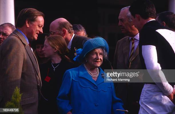 The Queen Mother attends the Grand Military Gold Cup accompanied by Andrew ParkerBowles Held annually at Sandown Park Racecourse in Esher Surrey it...