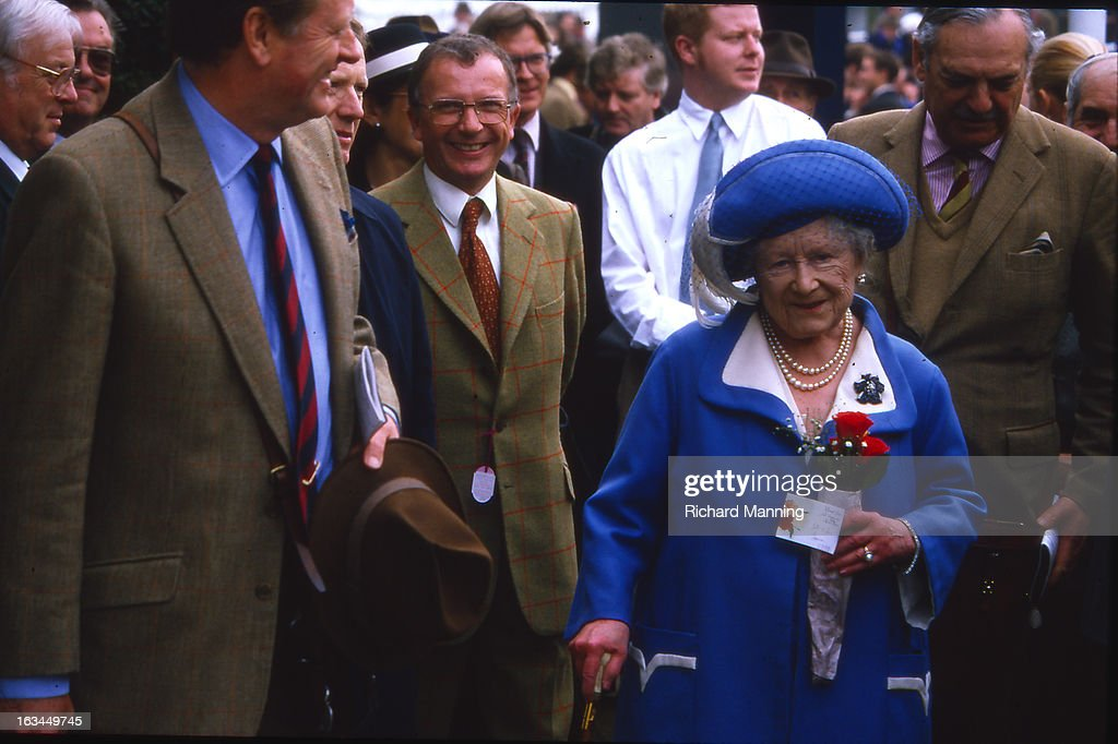 The Queen Mother attends the Grand Military Gold Cup accompanied by Peter Parker-Bowles (left). Held annually at Sandown Park Racecourse in Esher, Surrey it is a meeting point for the Military, in particularly for Cavalry Officers, with its origins in the days when mounted Cavalry Officers still rode to war.