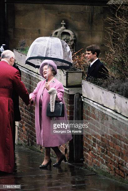 The Queen Mother followed by Prince Edward shakes hands with the Dean of Windsor after attending the Royal Christmas Service at St George's Chapel on...