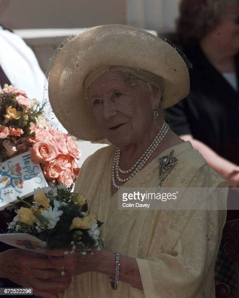 The Queen Mother holding flowers outside St James' Palace at an event to mark her 99th birthday London 4th September 1999